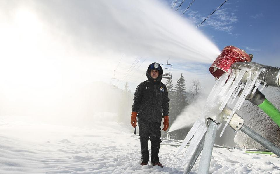 Doug Fichera applies a fresh layer at his family's Black Mountain area in New Hampshire, where he runs the snowmaking operation.
