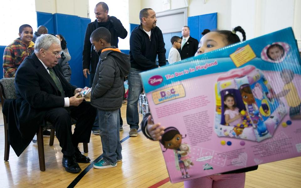 Mayor Menino talked gifts with Steven Dorosareo, 7, of Dorchester. Rhianna Dagraca, 2, of Medford is in the foreground.