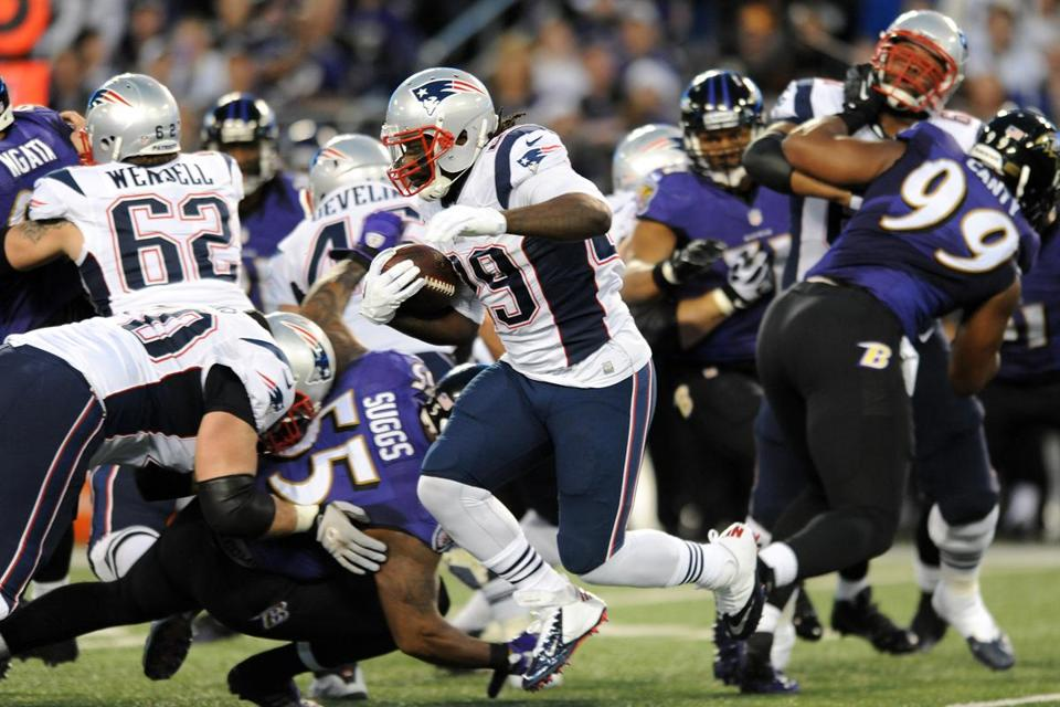 LeGarrette Blount (above) and Stevan Ridley pounded the Ravens for 130 yards on 31 carries, mostly out of the stretch play.