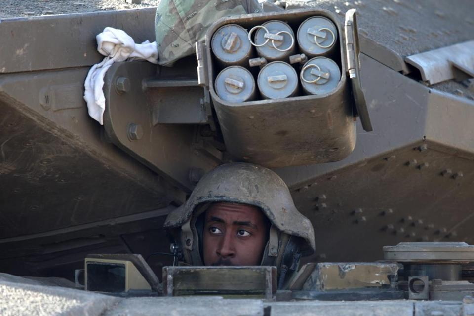 An Israeli soldier looked out from inside a Merkava Tank along the border with Gaza.