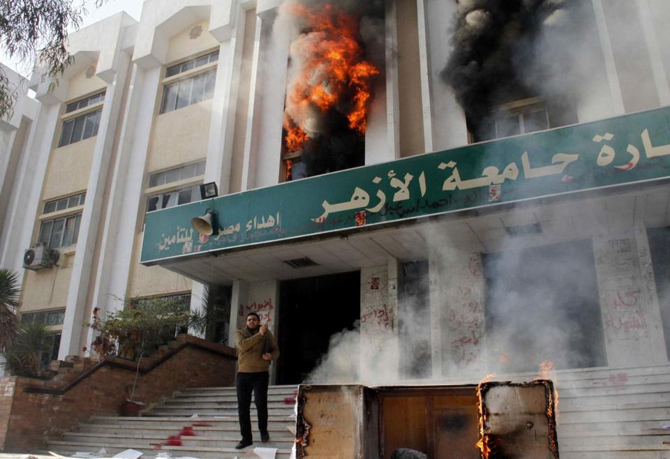 A man stood outside a faculty building at Cairo's Al-Azhar University after student supporters of the Muslim Brotherhood stormed it Saturday.