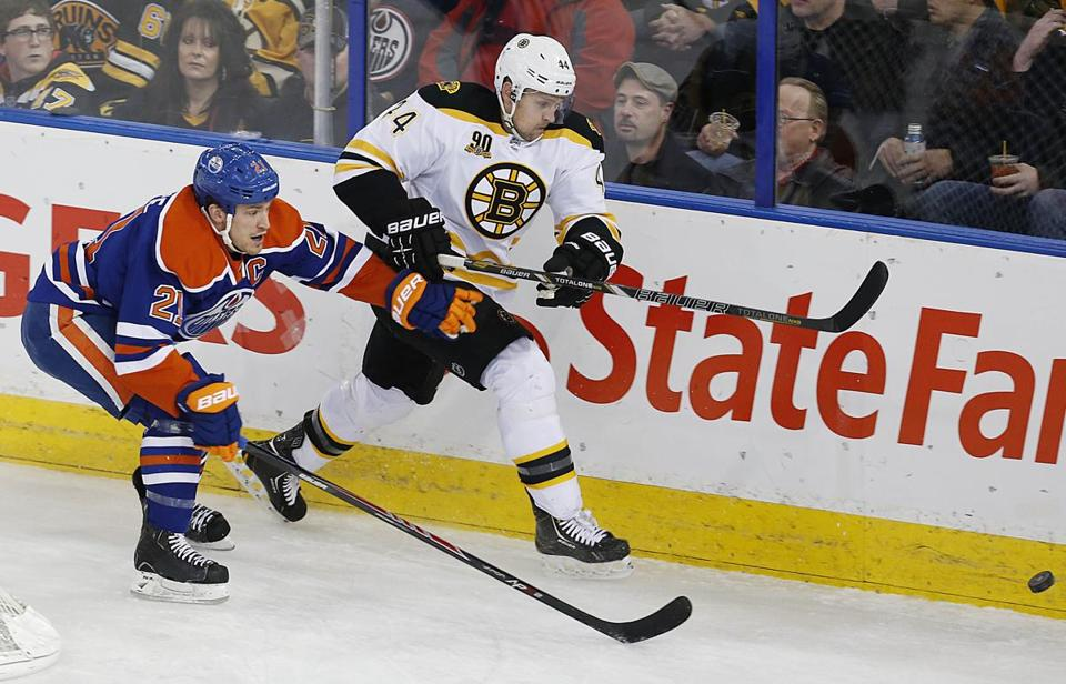 Bruins defenseman Dennis Seidenberg chased a loose puck during a game in Edmonton, Alberta.