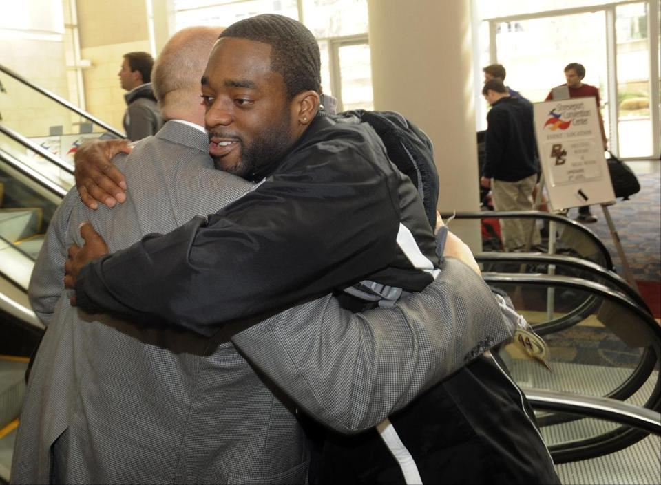 BC coach Steve Addazio hugs his All-America running back Andre Williams upon arriving in Shreveport.