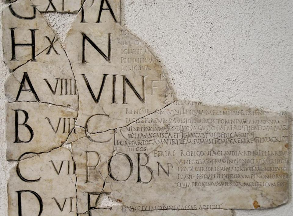 A detail from the Fasti Praenestini, a Roman calendar dated from the early first century. VIN is for Vinalia, a wine festival.