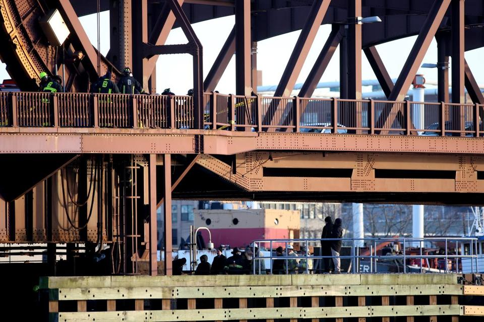 Police, fire, and other personnel were at the scene on the Meridian Street bridge after a woman was killed.