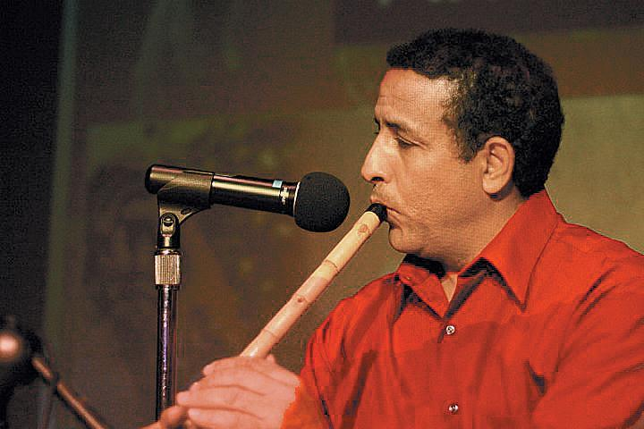 Boujemaa Razgui playng one of his flutes.