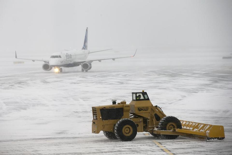 A Logan Airport official said runways were back to bare pavement by Friday afternoon.