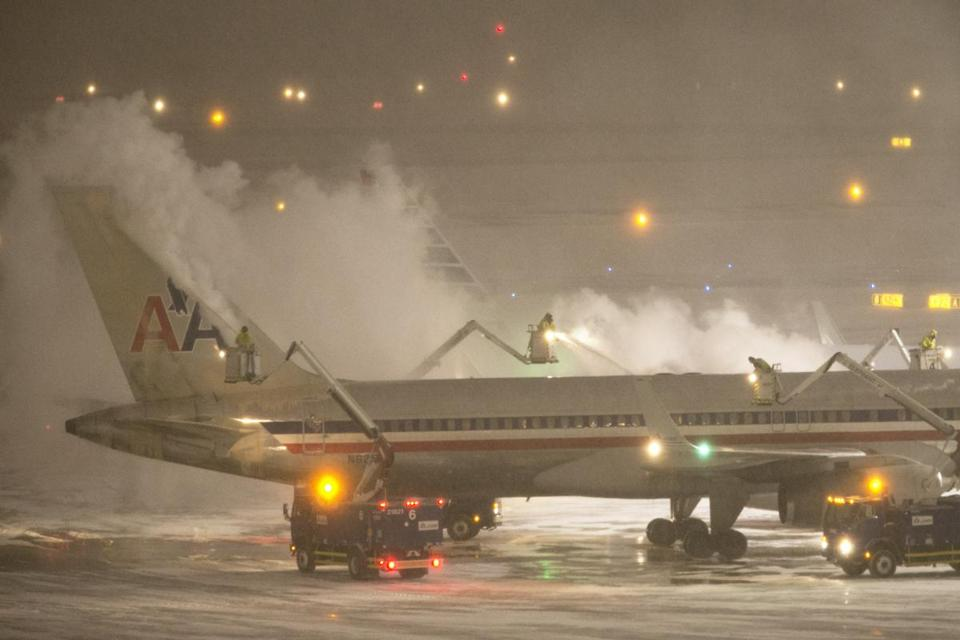 A plane was de-iced at Logan Airport on Thursday.