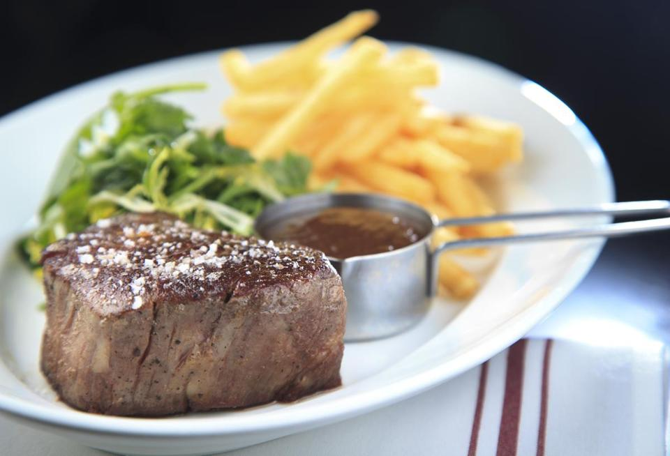 A filet mignon with frites and arugula salad at Boston Chops South End.