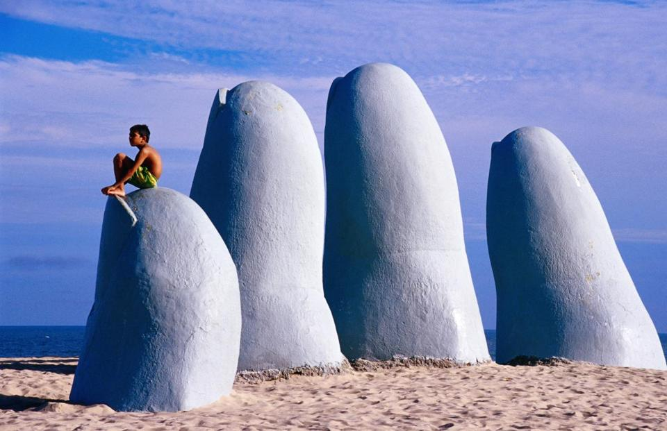 "Brava Beach gets its nickname ""Beach of the Fingers"" from the sculpture of cement fingers seeming to rise from under the sand."