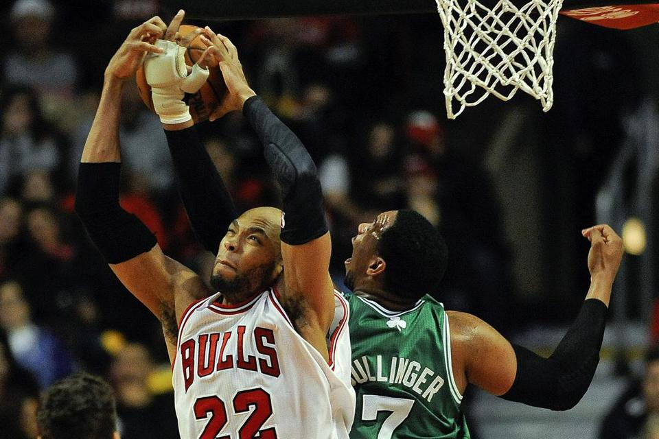 The Bulls' Taj Gibson grabbed the ball from Jared Sullinger in the second half.