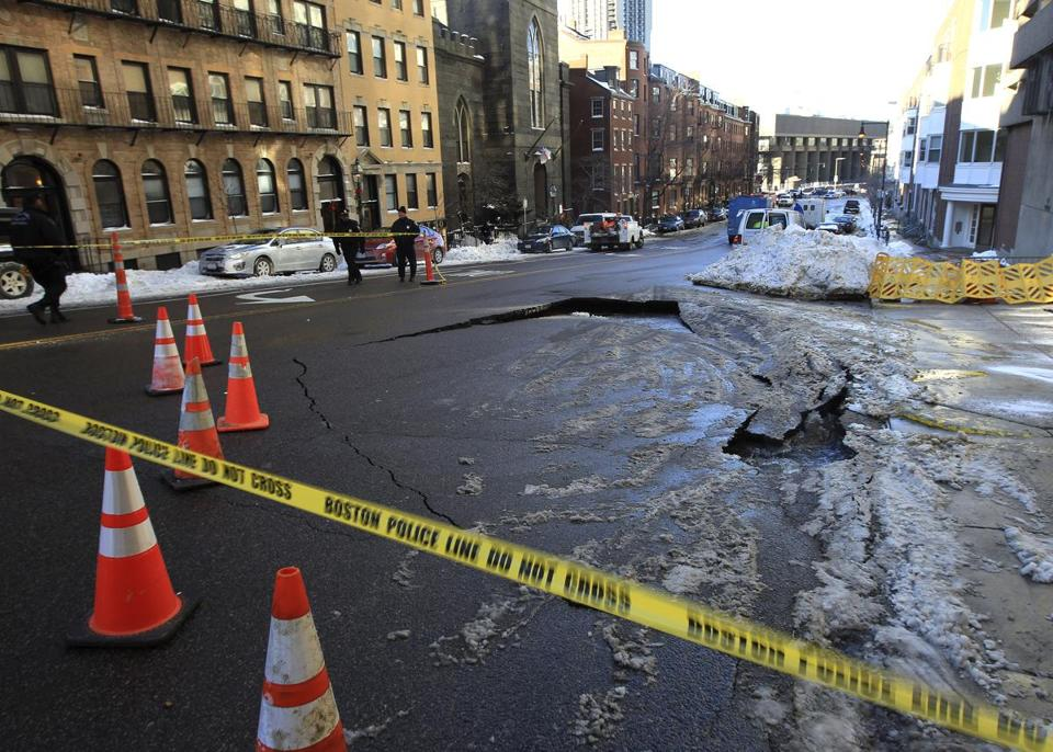 An underground fire pipe burst this afternoon, causing a partial road collapse and snarling traffic.