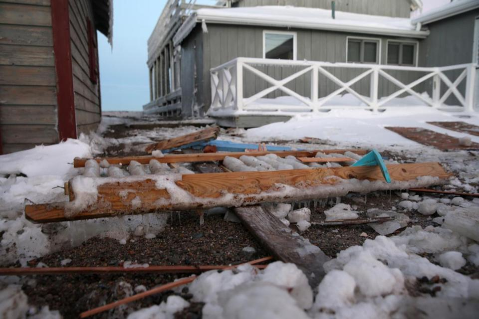 Debris left in the storm's aftermath, like this on Turner Road in Scituate, raised the possibility of costly repairs.