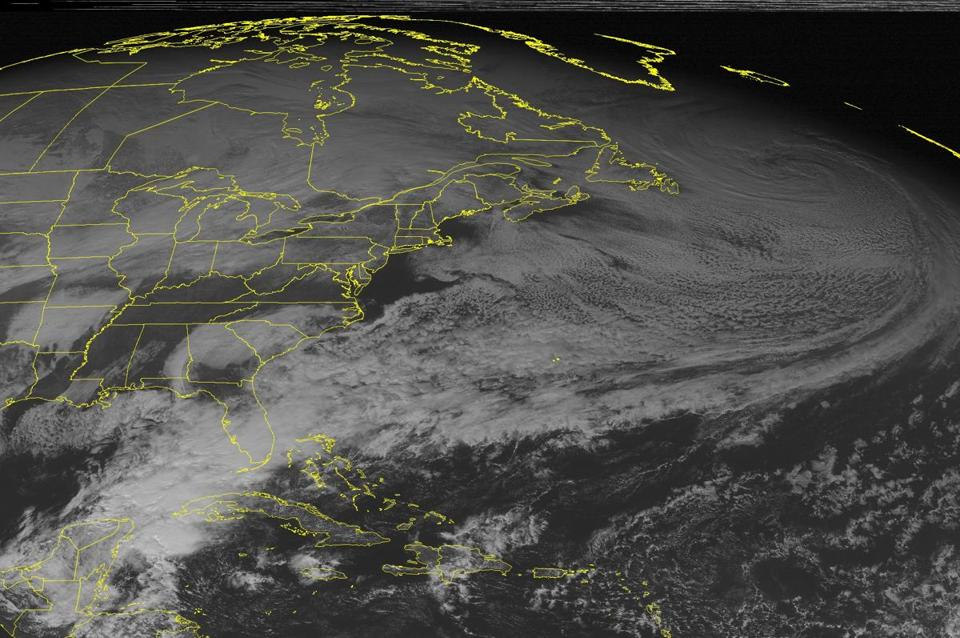 This NOAA satellite image taken Saturday at 1:45 p.m. shows a storm system taking shape over the Plains that was spreading clouds and a band of snow into the Upper Midwest and Great Lakes. This system will usher in one of the coldest air masses to affect the US in decades.