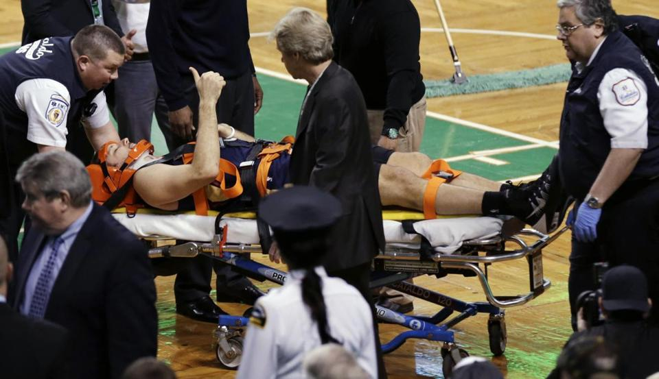 New Orleans's Ryan Anderson gives the thumbs up while he is removed from the court after a collision in the fourth.
