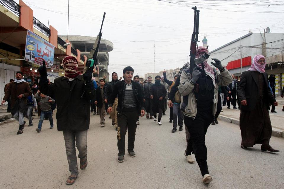 Mourners and Sunni gunmen chanted slogans Saturday against Iraq's Shi'ite-led government during the funeral of a man killed when clashes erupted between Al Qaeda gunmen and Iraqi army soldiers, his family said.