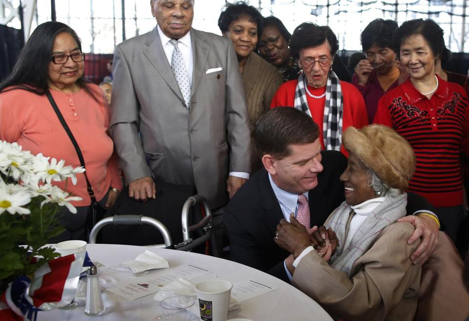 Martin J. Walsh gave Josephine Worrell, 101, of Boston a hug Sunday at a brunch for seniors at Northeastern University's Cabot Center.