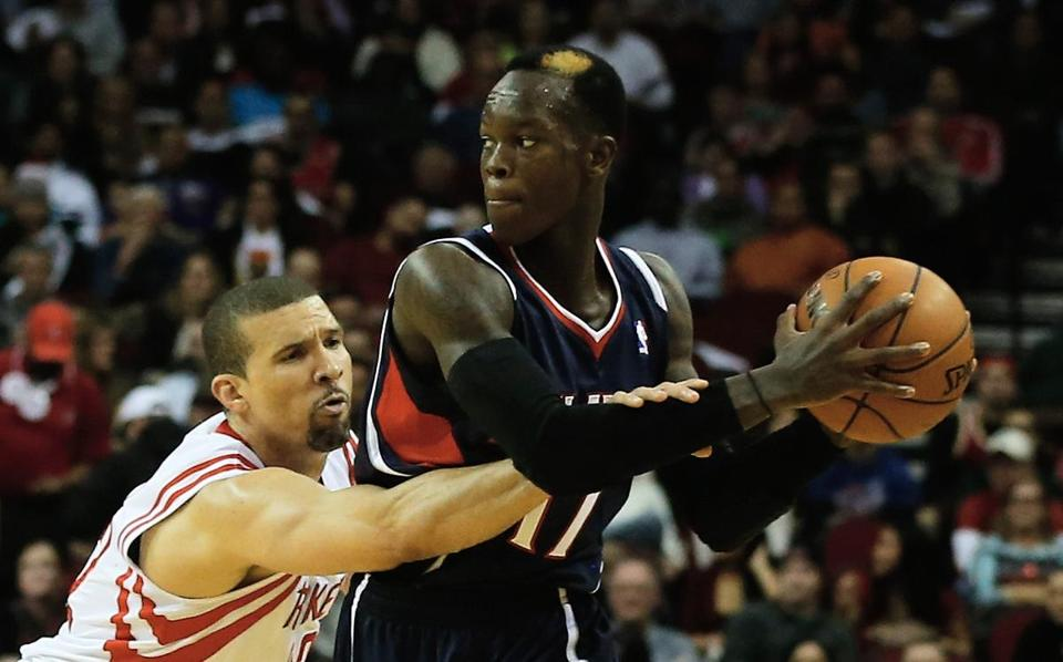 Hawks guard Dennis Schroder (right), who came to the NBA this season from Germany, has experienced an uneven rookie season.