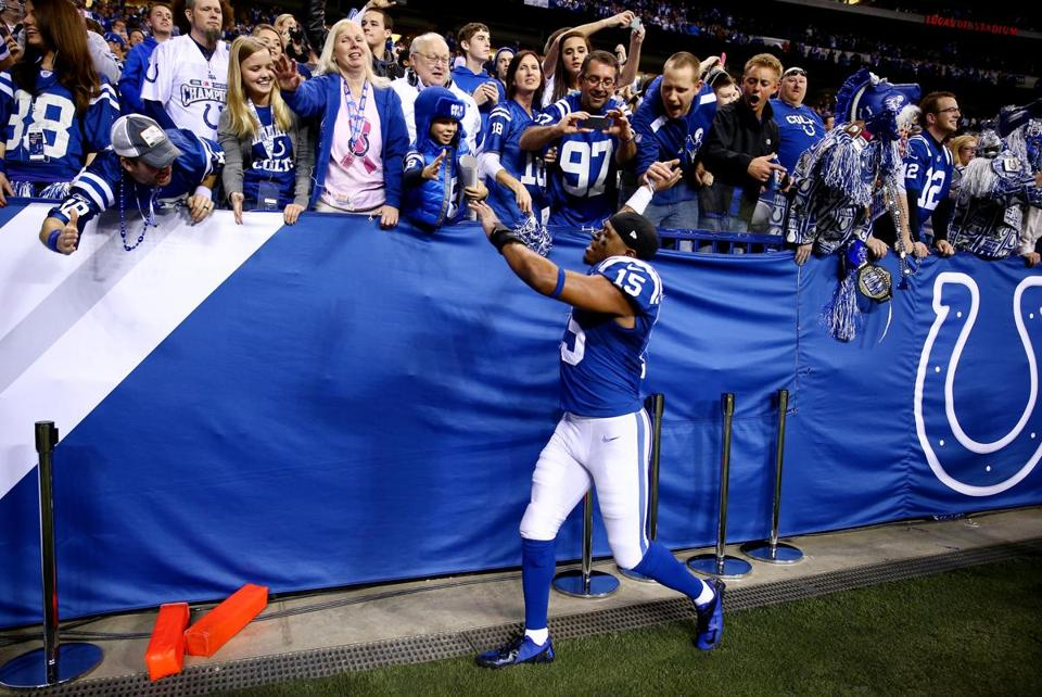 Colts wide receiver LaVon Brazill celebrated with fans after the remarkable comeback victory.