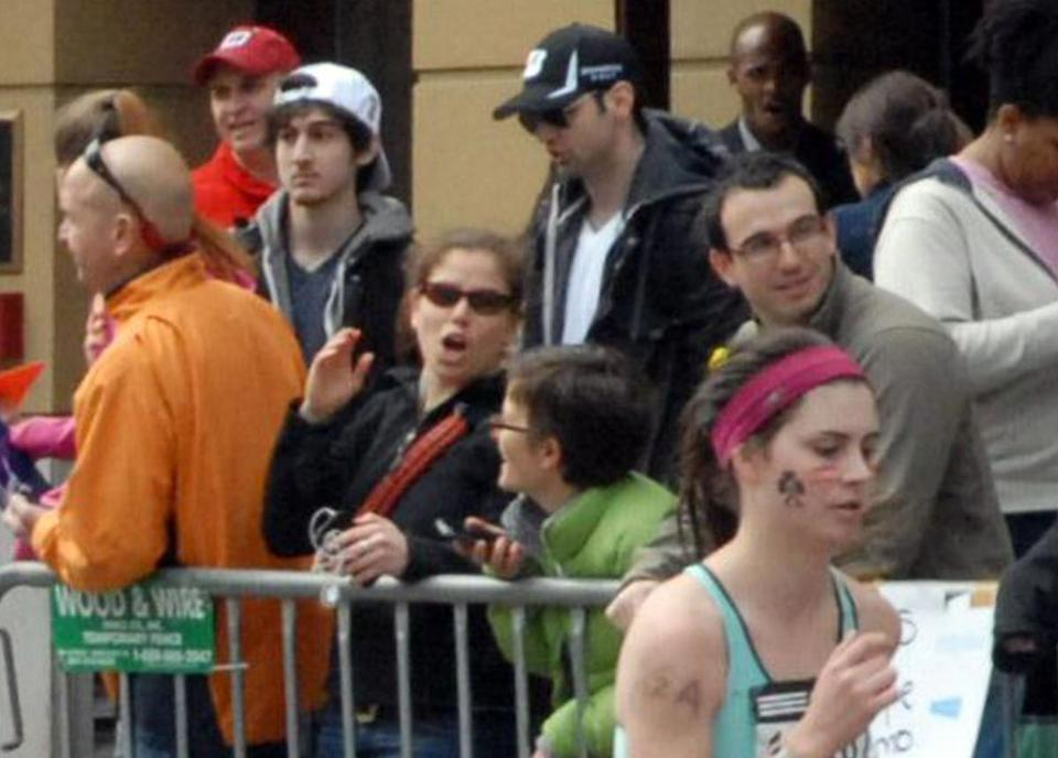 Tamerlan and Dzhokhar Tsarnaev, in black and white caps, stand near the Marathon finish line about 10 to 20 minutes before the blasts.