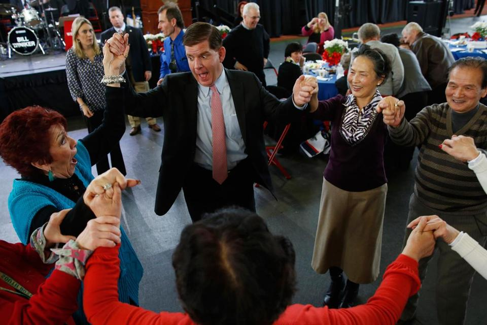 Mayor-elect Martin Walsh joined seniors in a dance at Northeastern University's Cabot Athletic Center on Sunday.