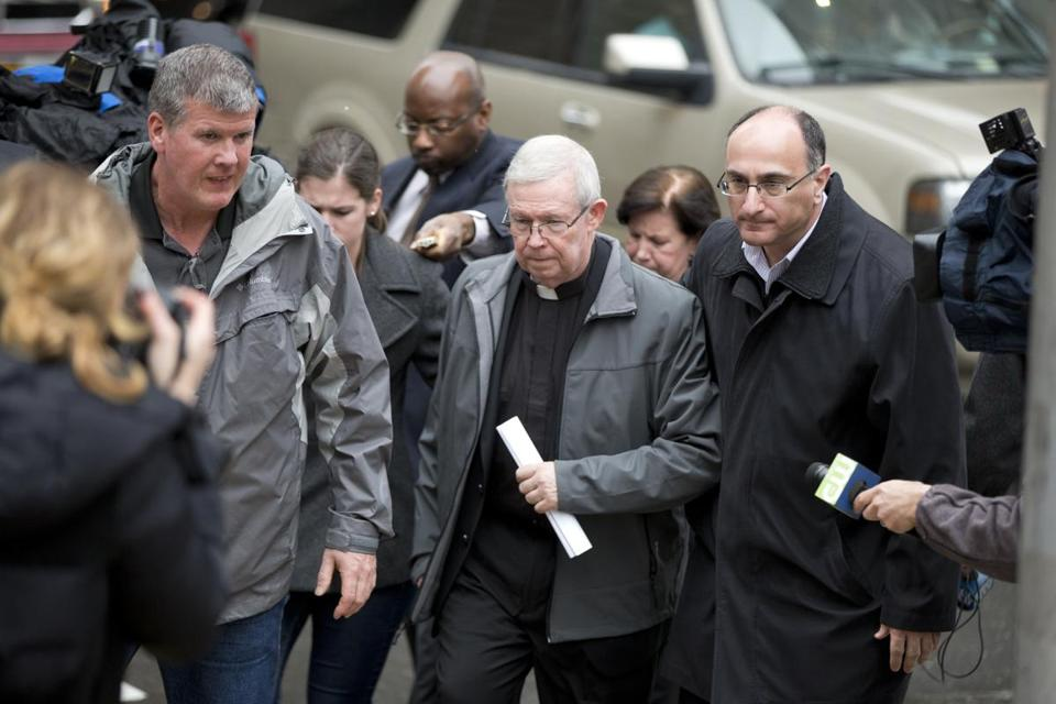 William Lynn, leaving a hearing Monday in Philadelphia, was convicted in a sex-abuse scandal but freed after an appeals court ruled that Pennsylvania's child-endangerment law in the late 1990s did not apply to supervisors such as Lynn.