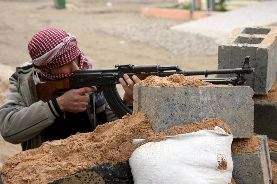 A gunman aimed his weapon during clashes with Iraqi security forces in Fallujah on Sunday.