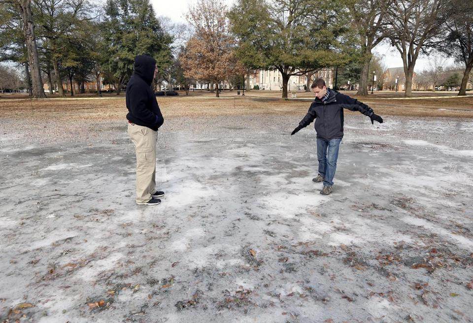 Ben Sigmon, left, and Joshua Moon, both students at the University of Alabama, explored ice on campus.