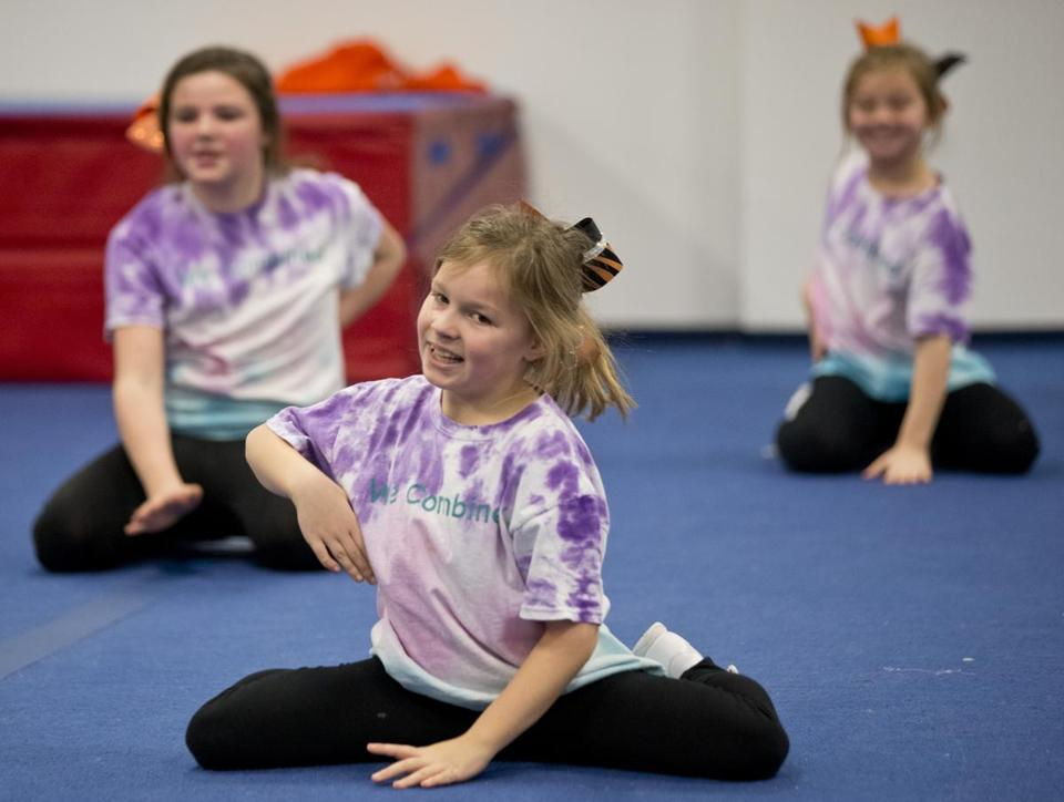 At cheerleader practice, Kristina Markos works on the routine with other girls on the team.