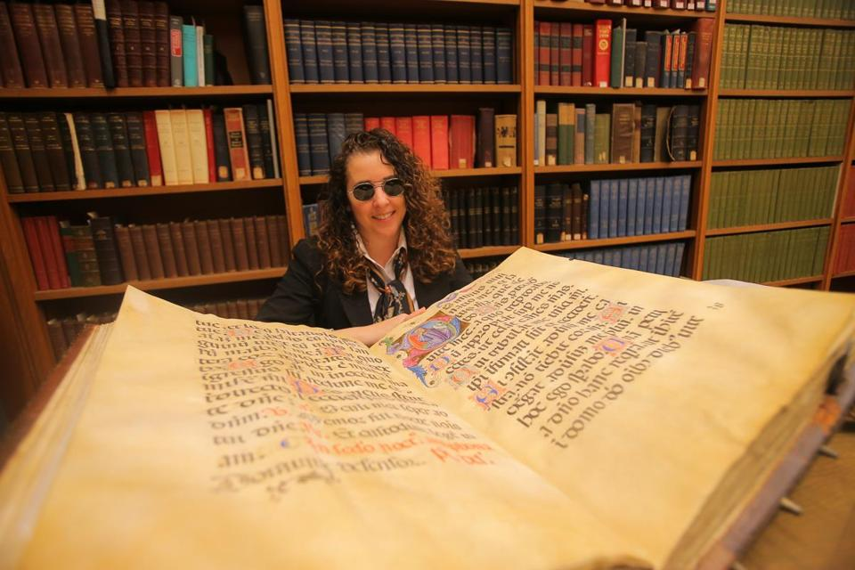 Lisa Fagin Davis studies Boston Public Library treasures.