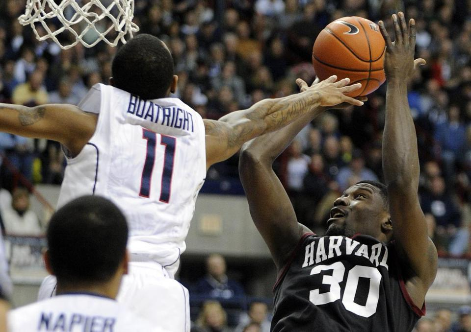 UConn's Ryan Boatright contests a shot from Harvard's Kyle Casey during the first half.