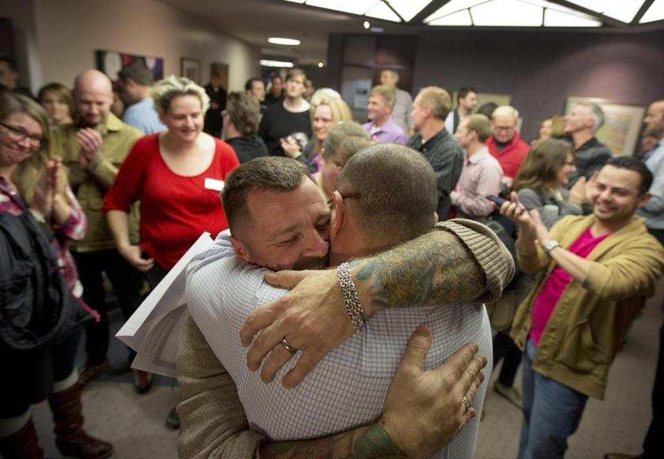 Chris Serrano (left) and Clifton Webb embraced after being married in Salt Lake City in December.