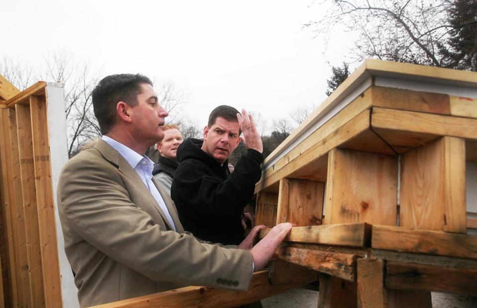 Mayor Martin J. Walsh and city councilors Timothy McCarthy (left) and Matt O'Malley put up a wall in a Habitat for Humanity project in Roslindale on Saturday.