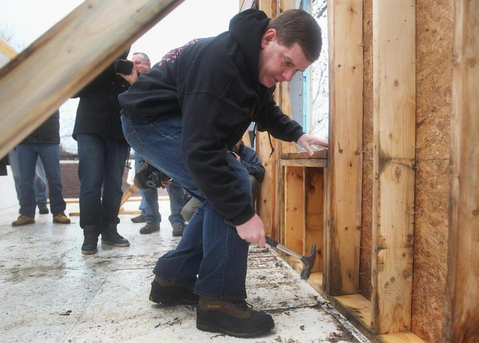 Mayor Martin J. Walsh hammered nails into a gable wall while participating in a Habitat for Humanity project on Saturday.