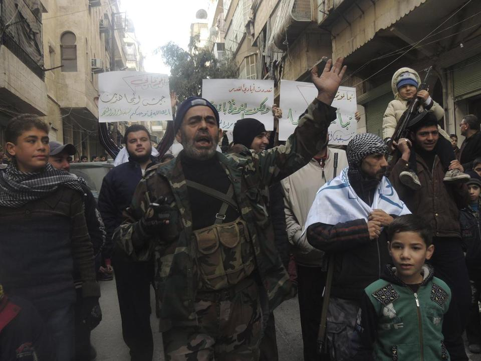 Civilians and Free Syrian Army fighters protested Friday against President Bashar Assad.