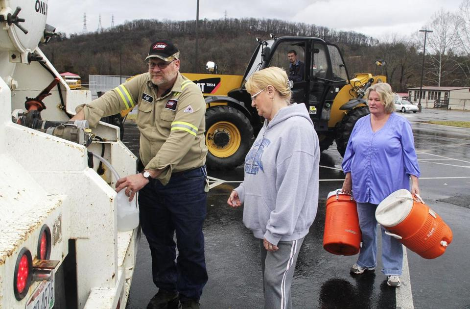 Residents of Putnam County, W.Va., filled containers with water at an emergency distribution center in Poca on Saturday. A chemical spill tainted the water supply.