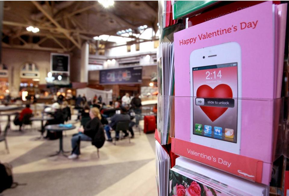 Valentine's Day cards at a South Station newsstand. MassDOT is seeking tales of romance at the station.