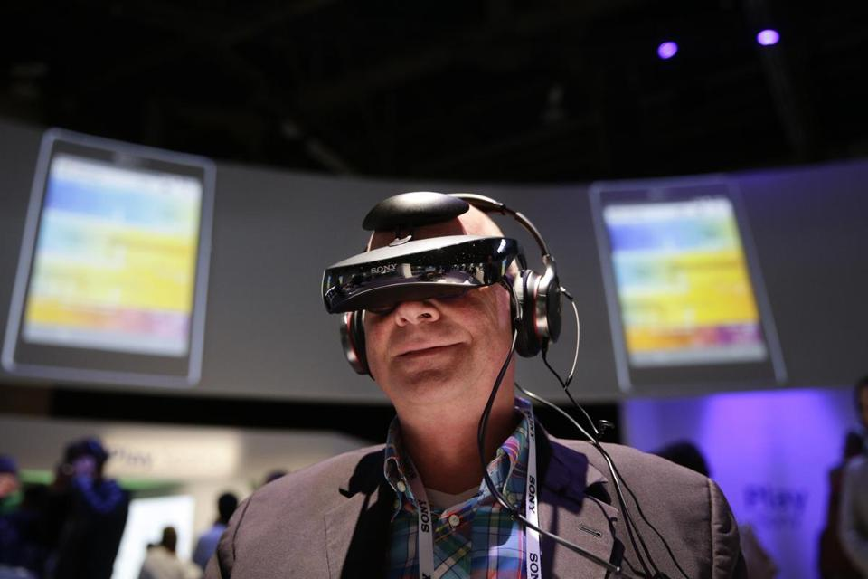 A man from Germany watched a video clip with a personal viewing device at the Sony booth during the Consumer Electronics Show in Las Vegas.