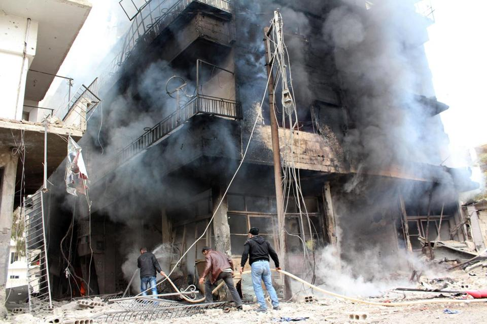 Buildings in Daraya, southwest of Damascus, burned as opposition forces fought Syrian government troops on Sunday.
