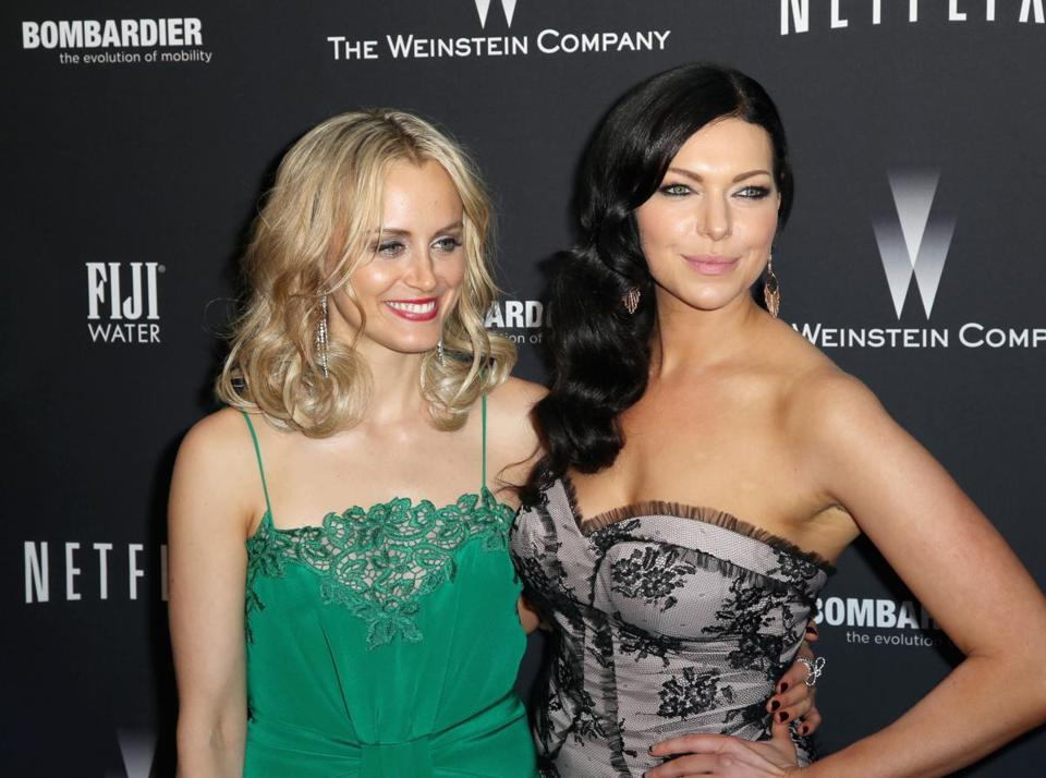 Taylor Schilling (left) and Laura Prepon at a Golden Globes event.
