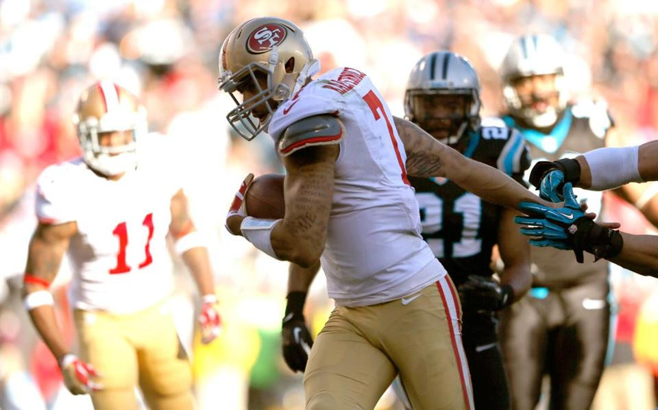 49ers quarterback Colin Kaepernick, who also threw for a score, finishes off a 4-yard touchdown run in third quarter.