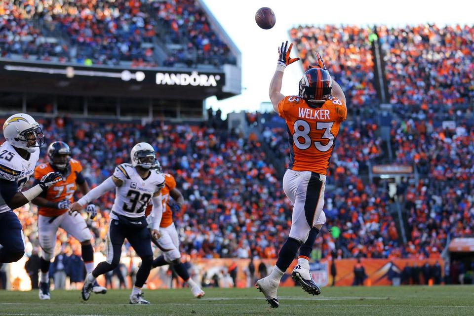 Wes Welker hauls in a 3-yard touchdown pass from quarterback Peyton Manning in the second quarter that helped the Broncos to a 14-0 lead.