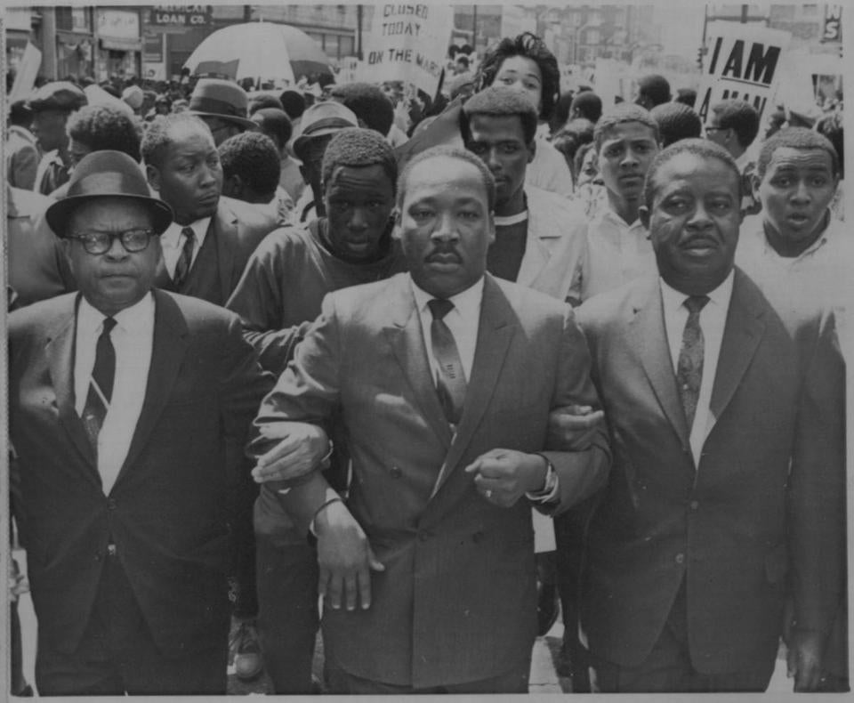 Dr. Martin Luther King Jr.  locks arms with assistant Rev. Ralph Abernathy (right) and Rev. H. Ralph Jackson (left) during a civil rights march in 1968 in Tennessee.