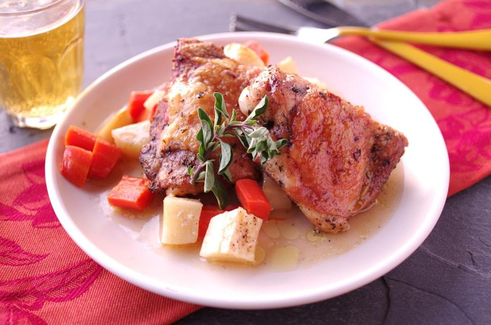 Roast chicken thighs with carrots and parsnips.