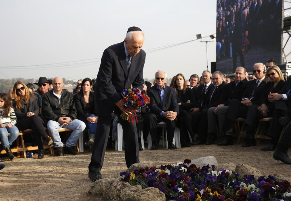 "Shimon Peres, Israel's president, called Ariel Sharon ""the shoulder on whom Israel's security rested."""