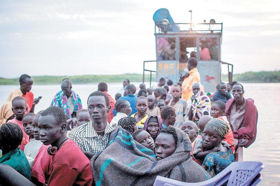 People displaced by fighting in South Sudan have sought safety by piling onto boats like this one on Jan. 9. Over the weekend, an overloaded ferry sank.