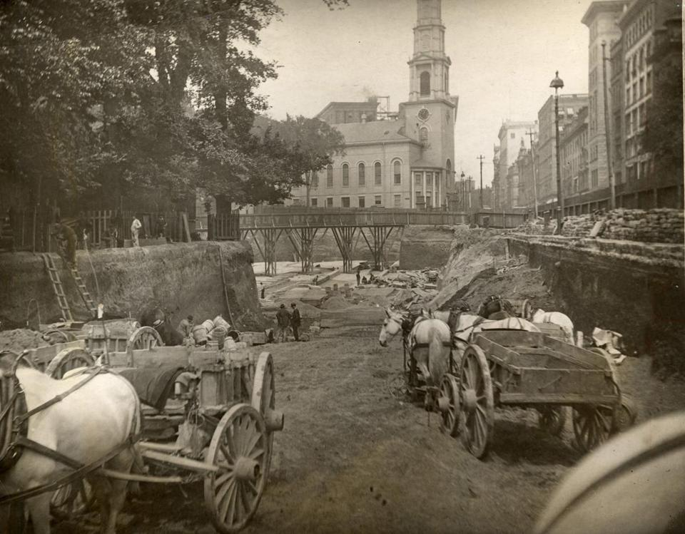 Boston broke ground on its subway in 1895, with workers digging the trench in sections. Horse-drawn carts carried away the dirt and rocks.