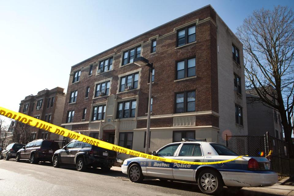 The apartment building on Esmond Street in Dorchester where an armed resident shot and killed one of two home invaders.