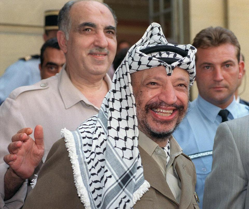 Salah Mesbah Khalaf, known as Abu Iyad (left) with Yasser Arafat in Paris in 1990.