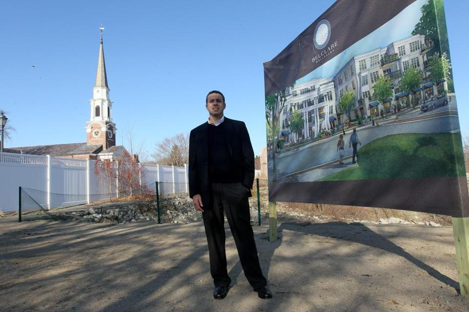 Noanet Group president Jordan Warshaw at the site of his 30-unit condominium project, which is taking the place of the Wellesley Inn.